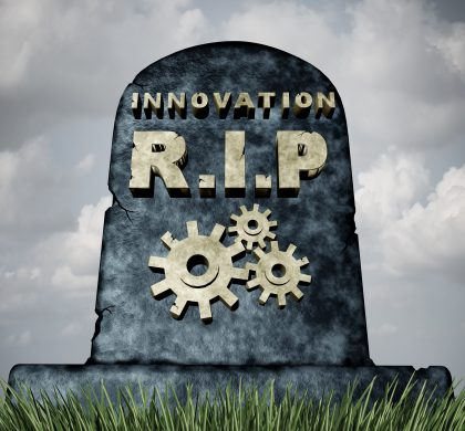 Failure to innovate and innovation problem as a grave stone with text and gear icons representing industry death due to lack of financial funding and technology vision resulting in a failed business.
